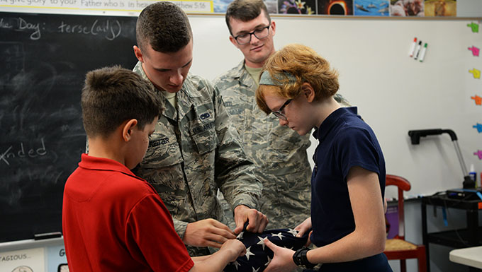 Airmen teach students proper flag procedures